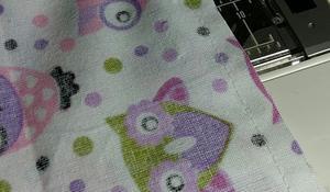 KROK VI - Zabezpieczanie krawędzi tkaniny